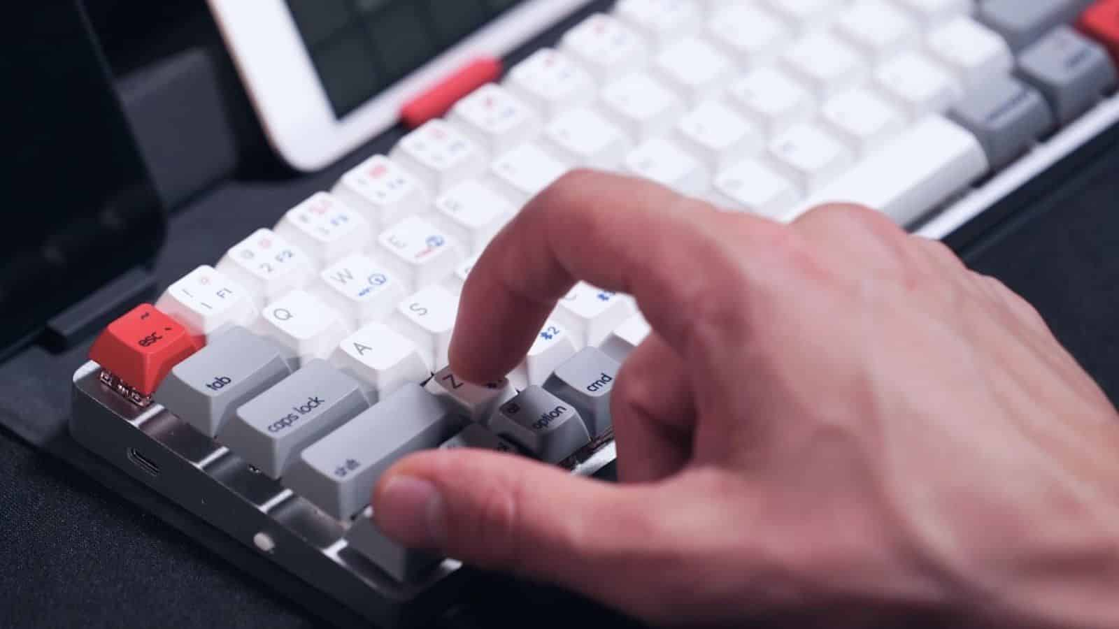 This adjustable wireless keyboard has mechanical switches and an invisible stand