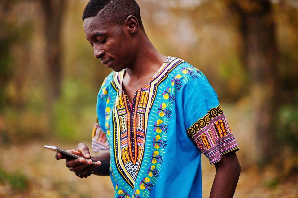 African man using his phone, African cryptocurrency market grows by more than 12 times in the past year