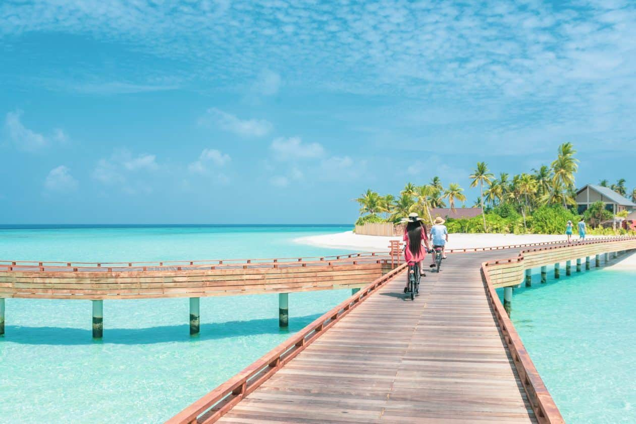 People riding a bike on a bridge in the Bahamas